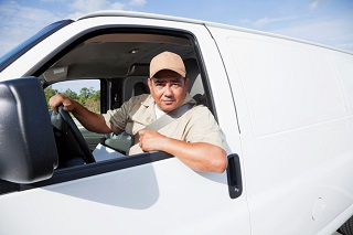 image of man in commercial work van